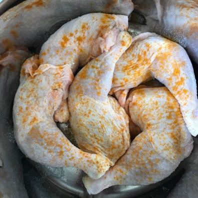 Chicken Legs in a pot with Salt and Turmeric